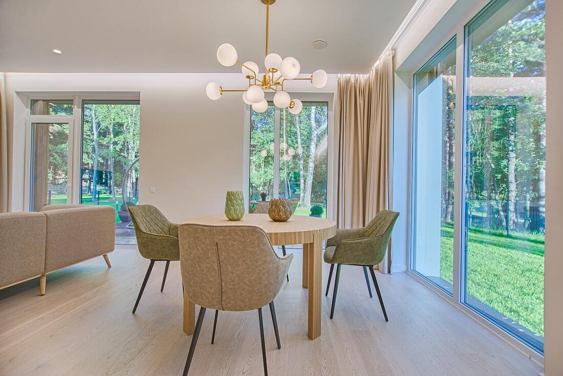 Bright Bay Area dining room with large floor to ceiling windows